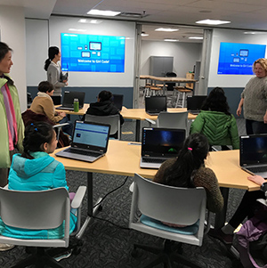 Image of coding workshop attendees in digital lab