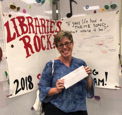 library patron holding prize envelope