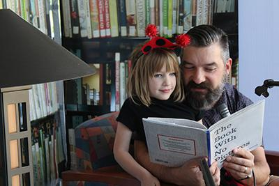 Picture from 2017 Readathon feature a dad and daughter reading together
