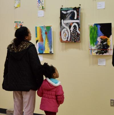 Mother and Daughter viewing art exhibit