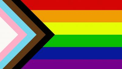 Image of pride flag 2020 featuring rainbow, blue, white, pink, black and brown stripes
