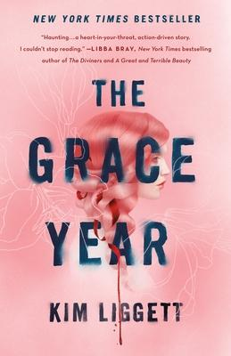 Pink book cover featuring an illustration in shades of red of a girl with a ribbon braided in her hair with the title The Grace Year in blue superimposed across the illustration.