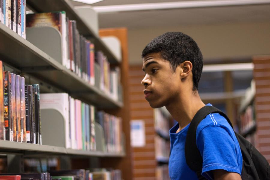 Teen in the stacks