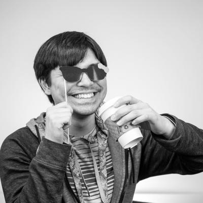 Photo of Joah with sunglasses and coffee cup