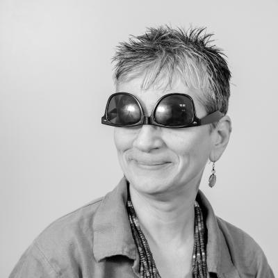 Photo of Kathy R wearing upsidedown sunglasses